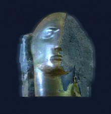An angel head half revealed in a block of dark stone one side of the face smooth, the other still rough textured quarried stone. The colours are dark blues and greens