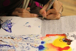 Sanchita Islam works on a scroll