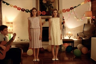 photo of two young women standing in a room
