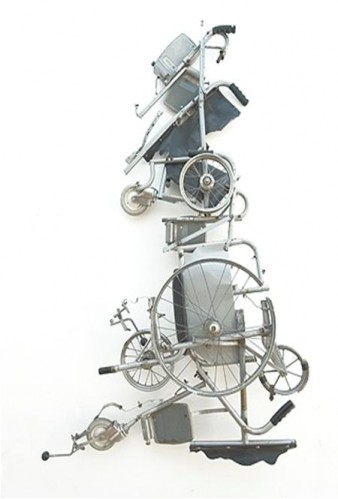 A black and white image of a sculpture made from wheelchair parts that defines the map of great britain