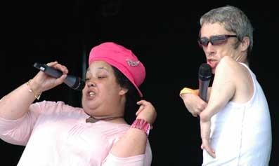 Lizzie Emeh and Mat Fraser sing together on stage at the Liberty Festival.