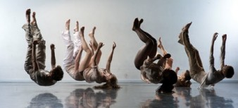 photo of a group of dancers with legs in the air