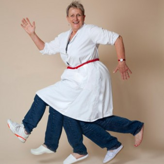 A woman in a white overall appears to be running on 5 legs.