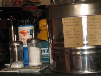 Two charidee boxes on a coffee counter asking for support on the Isle Of WIght for Scope and in Sooty's case support for RNIB